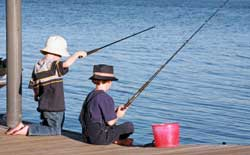 Photo of two children fishing