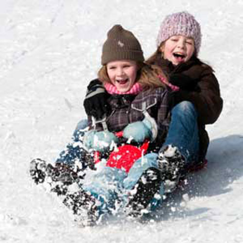 Photo of children sledding
