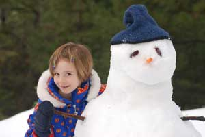 Photo of girl and snowman